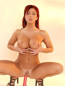 Sweet redhead girl with big natural tits toying her pussy