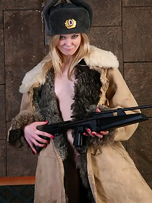 Blonde Sexy Chick Shows Shaved Twat Pose with Gun on Chair