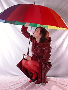 Red Bikini Sexy Chick Gives Warm Pose By Holding a Colour Umbrella