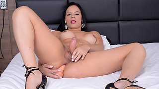 Brunette Shemale Inserts A Dildo Inside Her Asshole