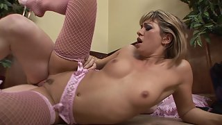 Natural-looking brunette ballerina in fishnets gets fucked on the sofa
