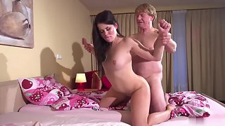 Older dick fucks the pussy of a young brunette