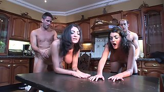 Two twin brunettes Kit Lee and Kat Lee are getting fucked in the kitchen