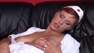 Redhead Stunning Nurse Rubbing Wet Twat and Squeezing Boobs
