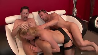Lusty Annette Schwarz has rough threesome sex with two dicks
