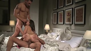 Hot brunette babe is stripped, licked, and fucked by two hard dicks