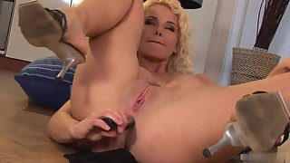 Busty blonde slut strips and jams a dildo inside