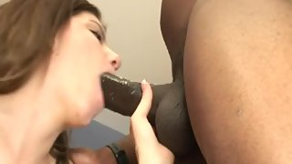 Cumhungry brunette sucks a big black cock and gets nailed