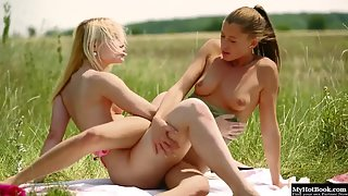 Hot blonde babes lick their pussies outdoors