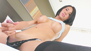 Asian transsexual Cartoon Candy plays with her cock like a real male
