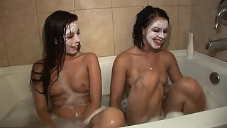 Two Brunette Teens with Juicy Tits Enjoying A Bathtub Together