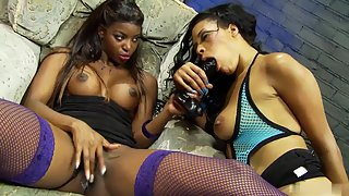 Hot ebony sluts are playing with hard toys