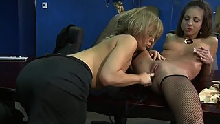 Two horny lesbo girls love to seduce each other at the work place