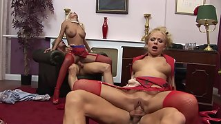 Amazing blondes in red fishnet stockings enjoy wild sex in the office